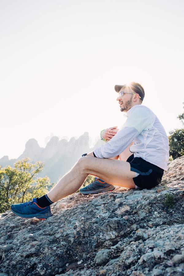 Portrait of athlete or man rest on top of mountain royalty free stock image