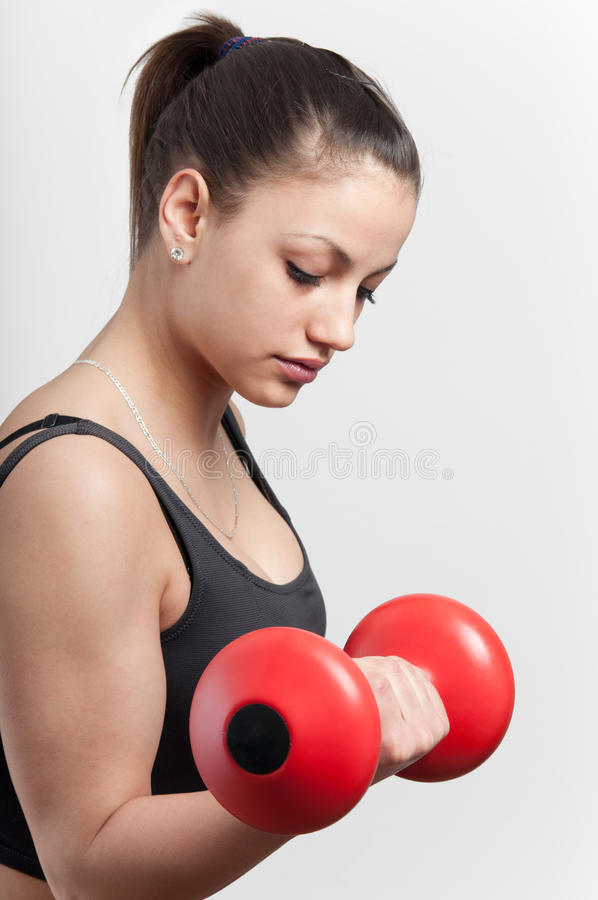 Strong attractive girl with dumbbell stock photography