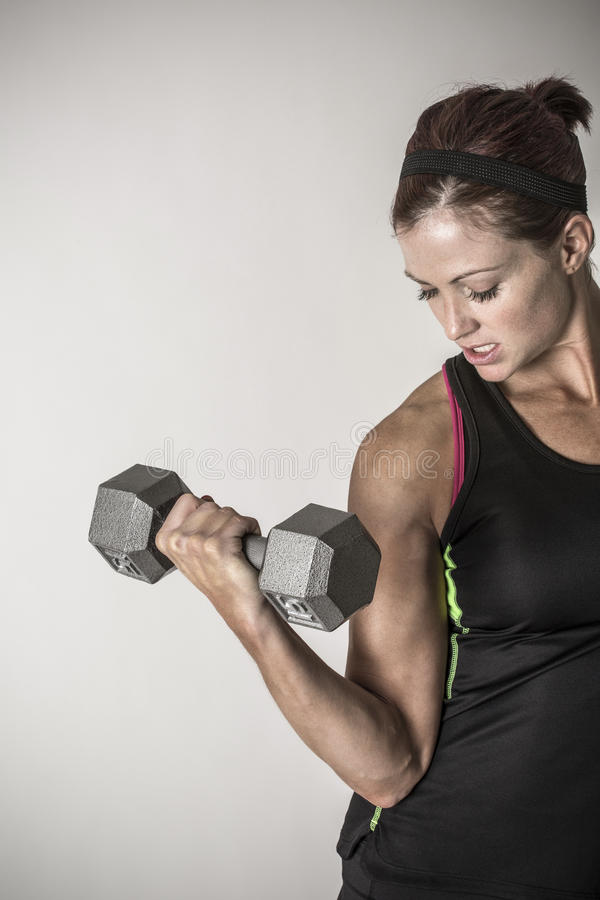 Download Strong Beautiful Fitness Woman Lifting Dumbbell Weights Stock Photo - Image: 83709297