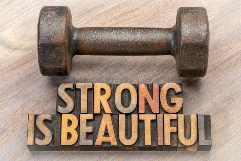Strong is beautiful - word abstract in vintage wood type stock photo