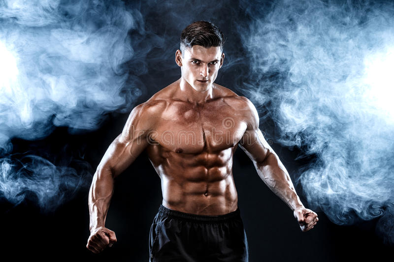 Strong bodybuilder man with perfect abs, shoulders,biceps, triceps, chest. royalty free stock images