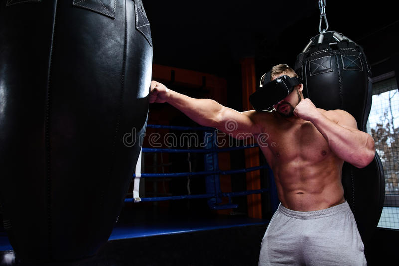 Strong boxer fights in VR glasses stock photo