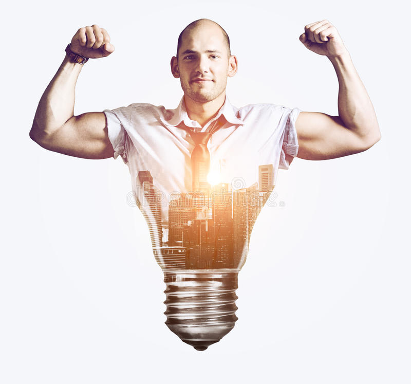 Strong business idea. Businessman showing muscular hands, double exposure mixed with sunset city skyline and bulb stock image