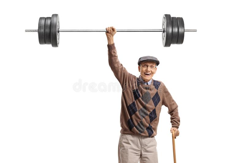 Strong cheerful senior lifting a barbell royalty free stock image