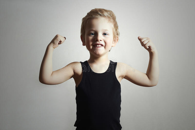 Strong Child. Funny Little Boy. Sport Handsome Boy. Child. Funny Little Boy. Sport Handsome Boy. Strong. bodybuilder. showing his hand biceps muscles stock image