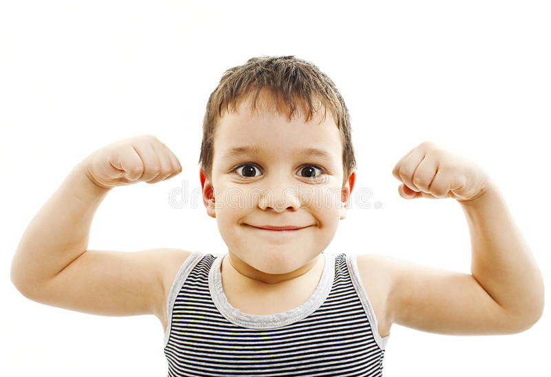 Strong Child Showing His Muscles. Child. Funny Little Boy.Sport Handsome Boy. Strong. bodybuilder. showing his hand biceps muscles. Isolated on white background stock photography