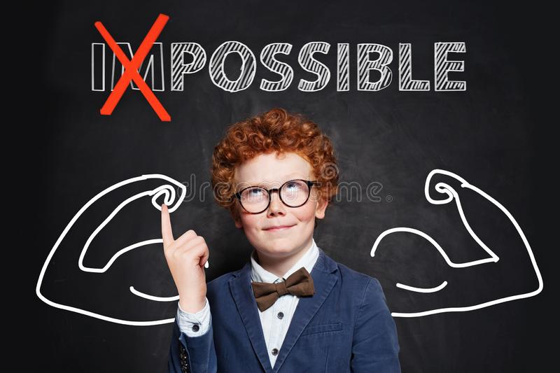 Strong clever child boy with text possible on black background. Success and develop concept royalty free stock images