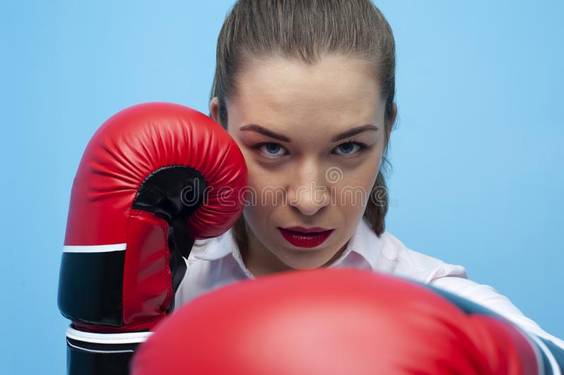Strong and confident businesswoman wearing blouse and boxing gloves. Take a punch. Portrait of Strong and confident businesswoman wearing blouse and boxing stock images