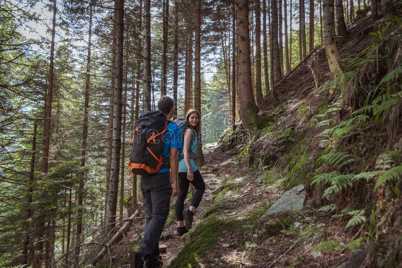 Strong couple hiking in the mountains stock photos