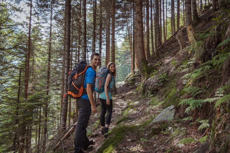 Strong couple hiking in the mountains stock images