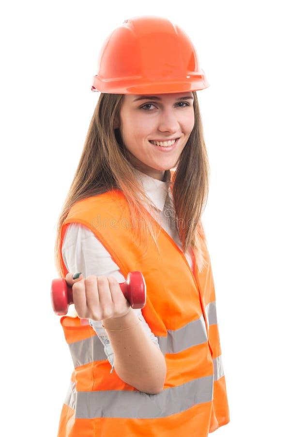 Strong female architect lifting dumbbell stock photo