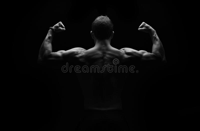 Strong fitness man flexing royalty free stock photos