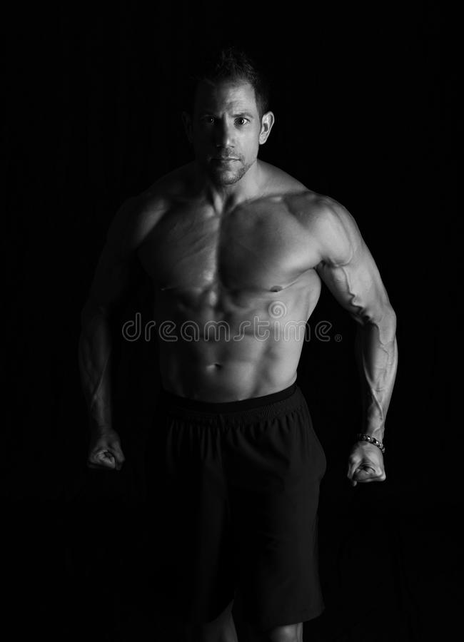 Strong fitness man flexing royalty free stock photo