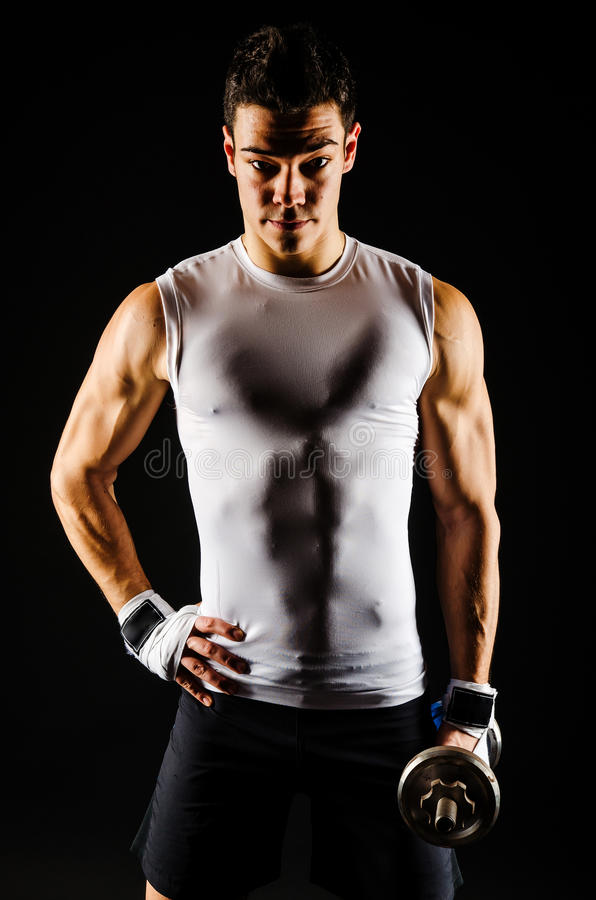 Strong fitness man relaxing after workout royalty free stock photos