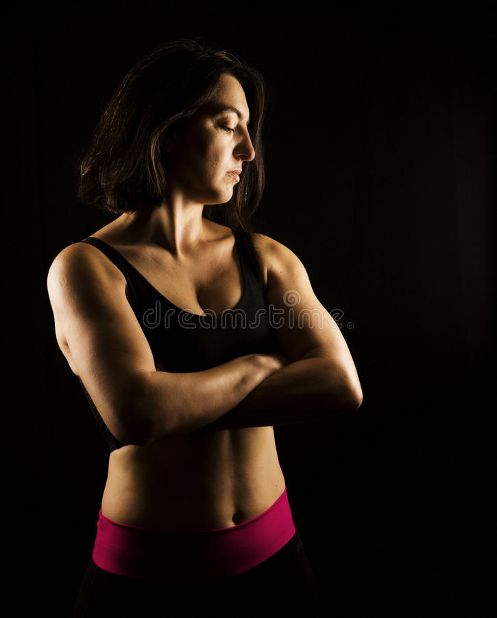 Strong fitness woman posing royalty free stock photography