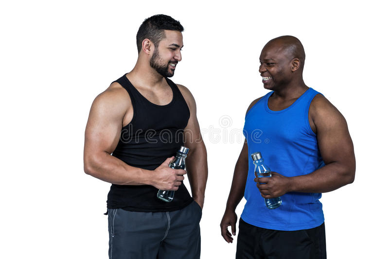 Strong friends taking a drink royalty free stock image