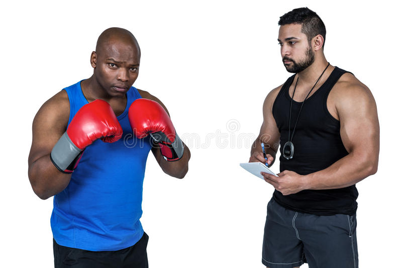 Strong friends using kettlebells together royalty free stock photo