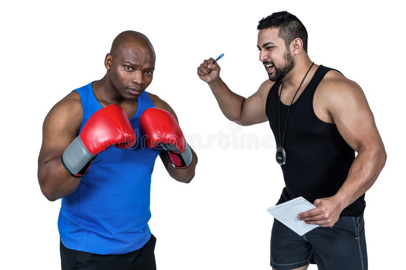 Strong friends using kettlebells together stock image