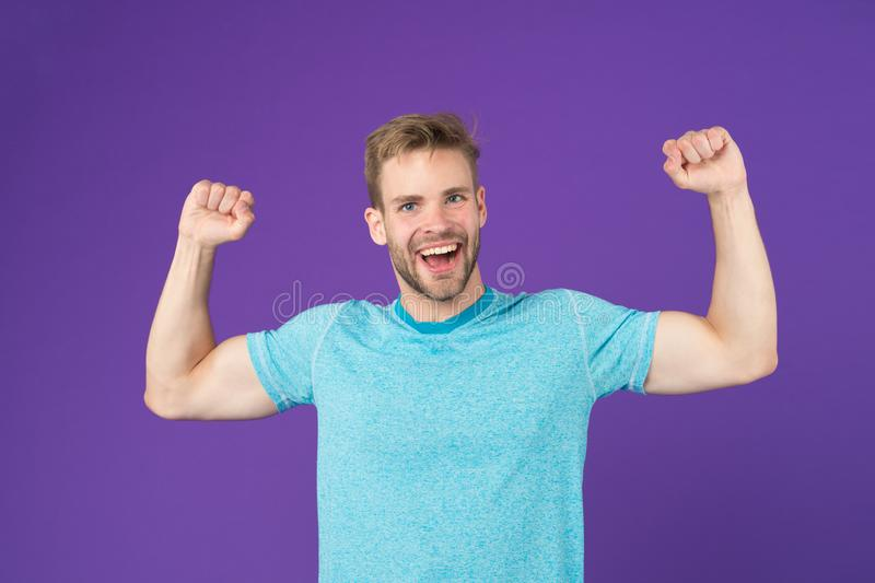 Strong and full of energy. Man strong handsome unshaven guy on violet background. Masculinity concept. Man with muscular. Arms confident and strong. Does having royalty free stock photo