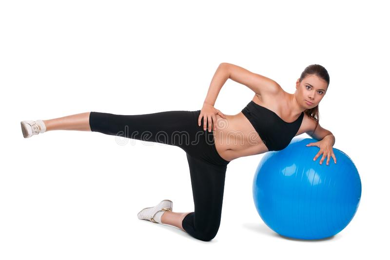 Strong girl excersicing with fitball
