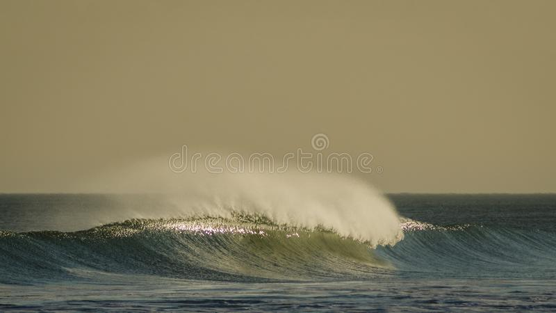 Strong golden waves windy day in atlantic sea stock image