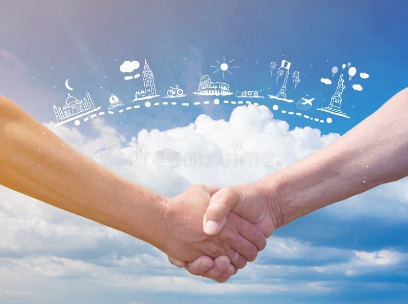 Strong handshake on blue sky stock photo