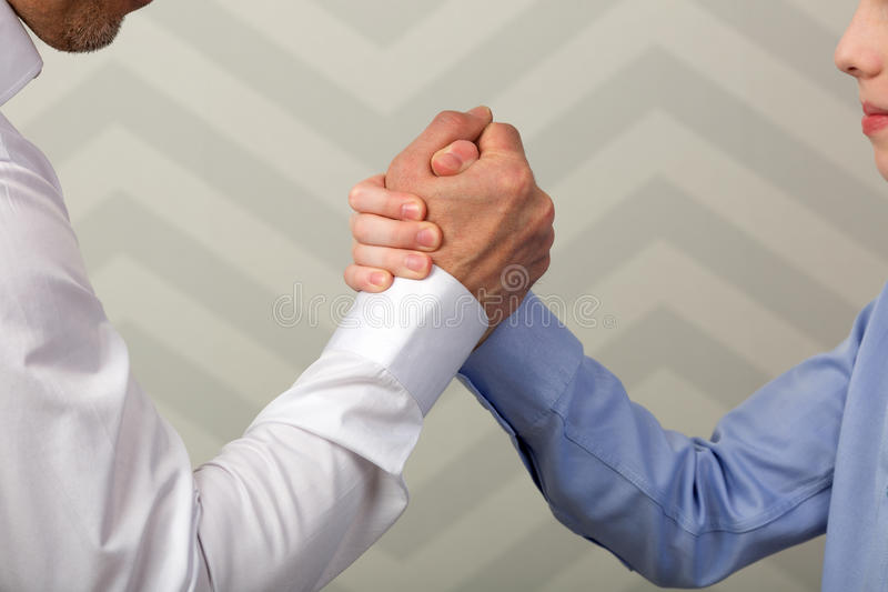 Strong handshake of father and son stock photo