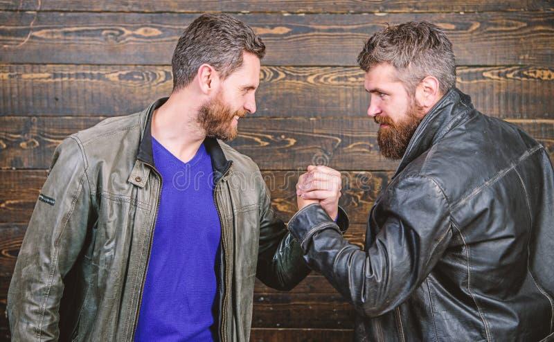 Strong handshake. Friendship of brutal guys. Handshake symbol of successful deal. Approved business deal. Handshake stock image