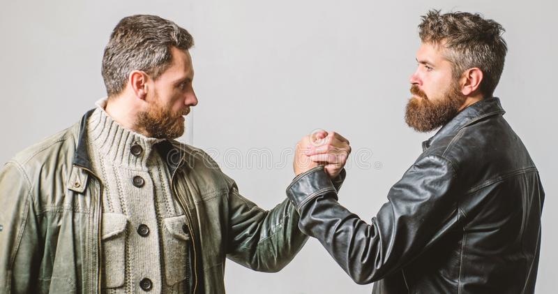Strong handshake. Friendship of brutal guys. Leadership concept. True friendship of mature friends. Male friendship royalty free stock photography
