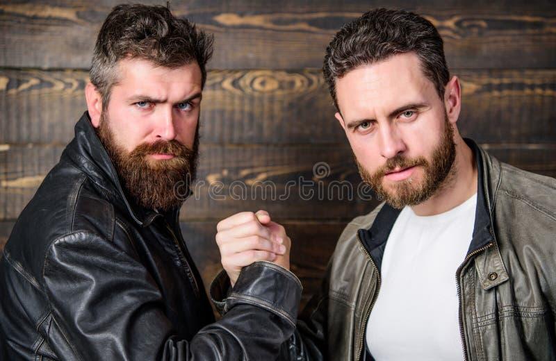 Strong handshake. Friendship of brutal guys. Mafia dealer. Real friendship of mature friends. Male friendship concept. Brutal bearded men wear leather jackets stock photos