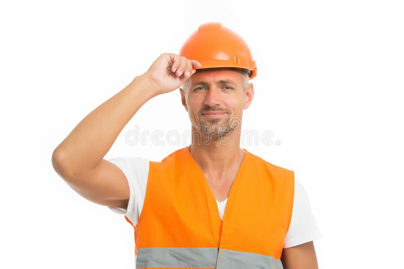 Strong handsome builder. Good job. Safety is main point. Man builder wear protective hard hat and uniform white stock photo