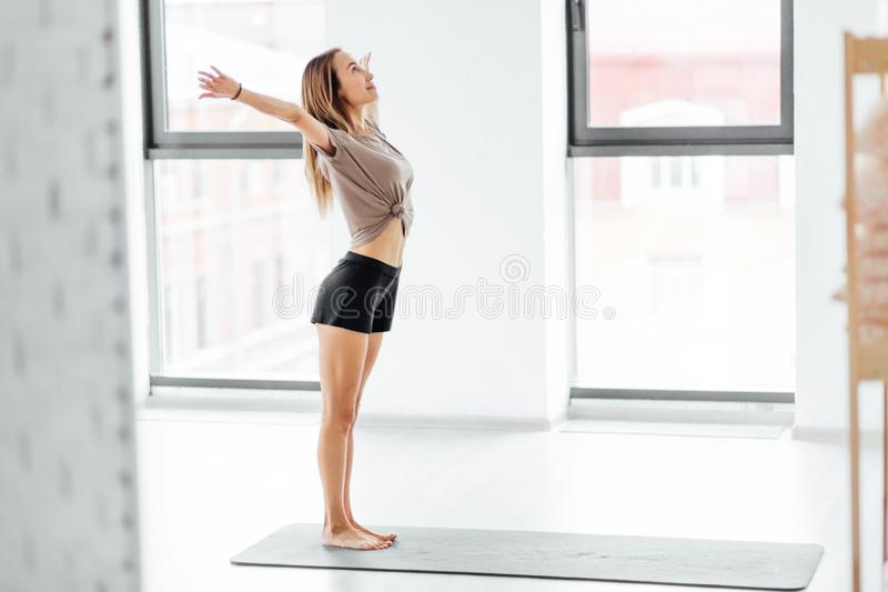 Strong happy woman with open armsmeeting the morning royalty free stock photo