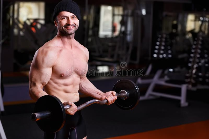 Strong healthy adult ripped man with big muscles training with b stock photos