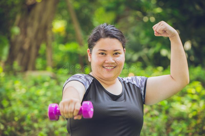 Strong and healthy overweight fat girl, outdoor sport royalty free stock images