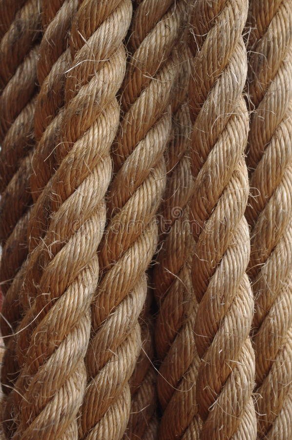 Strong, Hemp rope, cord or line, with rough fiber, made of jute. Used by sailing and climbing stock photos