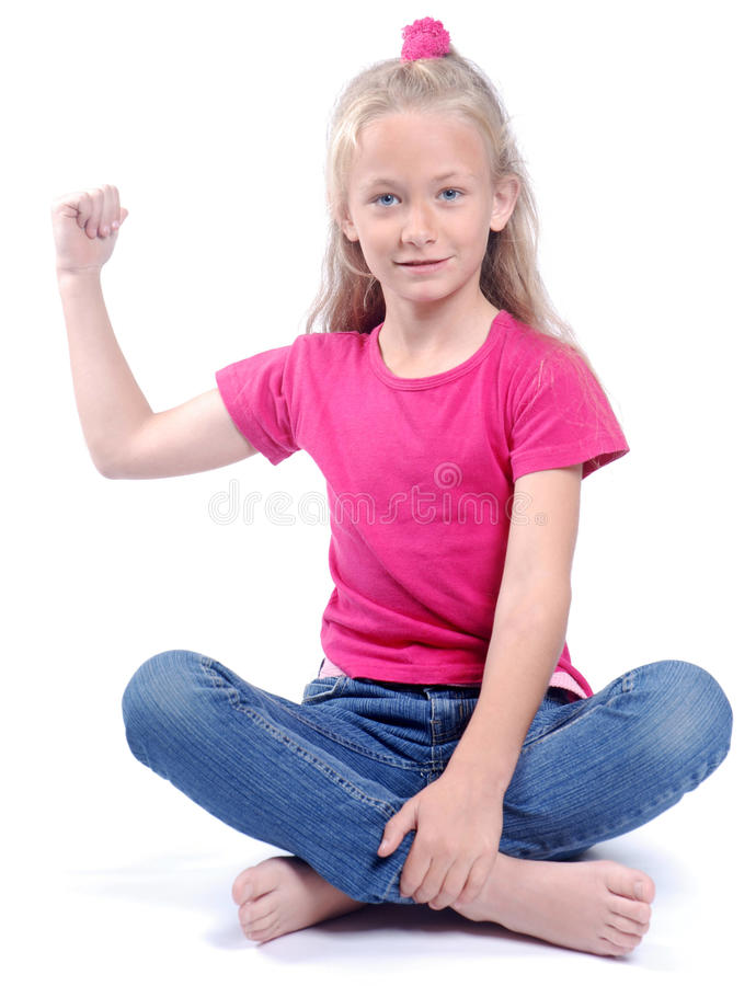 Strong little girl on white royalty free stock photography