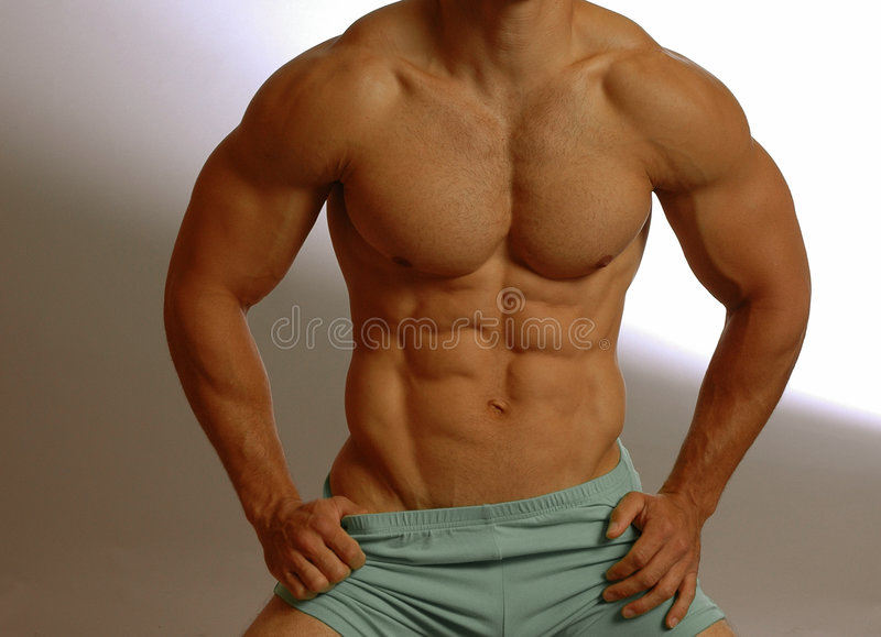 Strong male abs royalty free stock photography