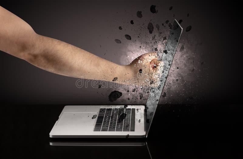 Hand breaks laptop glasses. Strong male hand breaks laptop screen glasses stock image