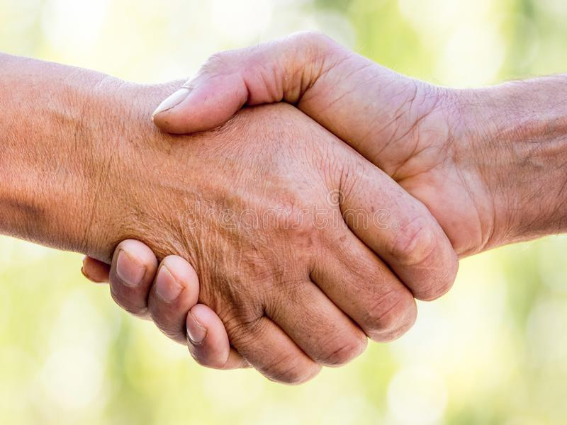 Strong male handshake closeup. Successful businessmen handshaking after good deal_ royalty free stock images