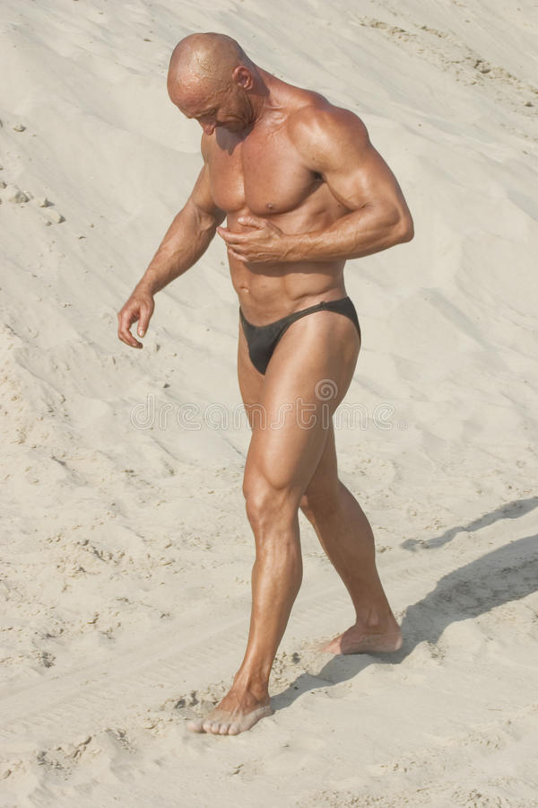 Download Strong man stock photo. Image of exercise, male, beach - 23509652