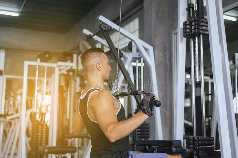 Strong men doing exercises training,Cross fit body and muscular in the gym. Strong man doing exercises training,Cross fit body and muscular in the gym stock photos