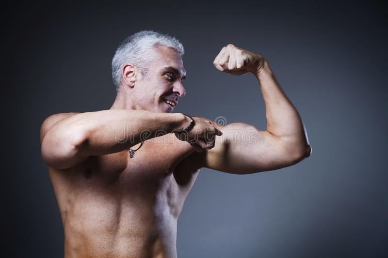 Strong Man Fitness Model Torso showing flexing bicep muscle Hea royalty free stock image