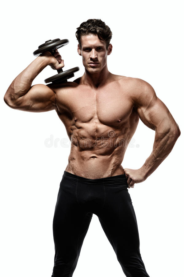 Strong man with perfect abs, shoulders, biceps, triceps and chest royalty free stock photography