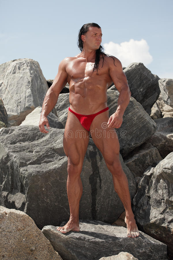 Download Strong Man Posing On The Rocks Stock Photo - Image: 21395246