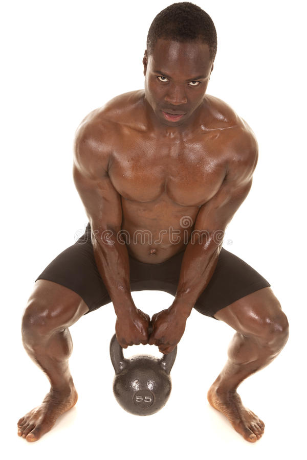 Strong man sweat squat with weight stock photos