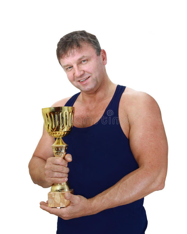 Strong man with winner cup stock photos