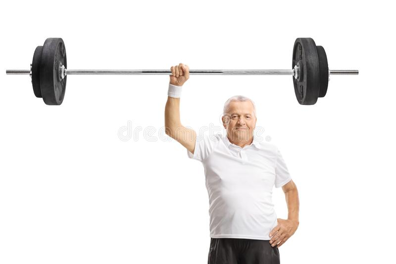 Strong mature man lifting a barbell with one hand royalty free stock photos