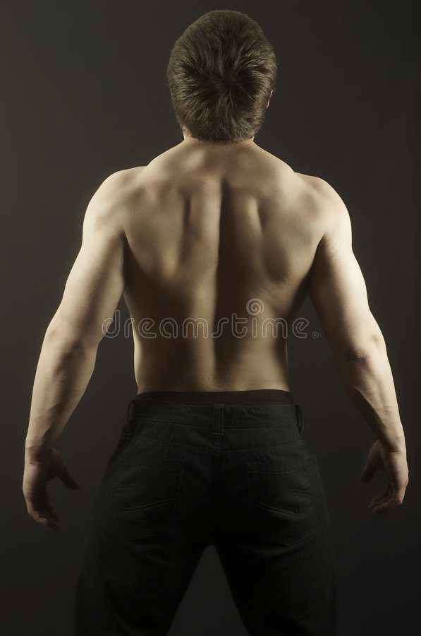 Strong men. The young man of an athletic constitution plays sports royalty free stock photo