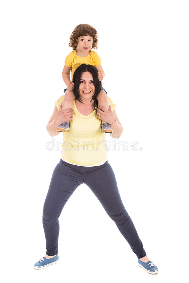 Strong mother carrying little son royalty free stock photo