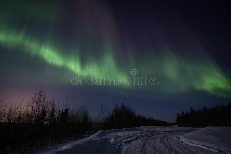 Strong multicolor display of northern lights stock photography